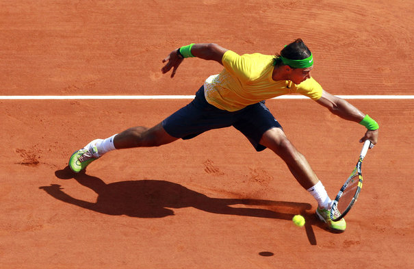 Rafael Nadal of Spain returns the ball to his compatriot David Ferrer during their final of the Monte Carlo Masters tennis tournament in Monaco April 17, 2011. REUTERS/Eric Gaillard (MONACO - Tags: SPORT TENNIS)